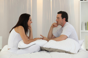 bigstock_Couple_talking_in_bedroom_12641702